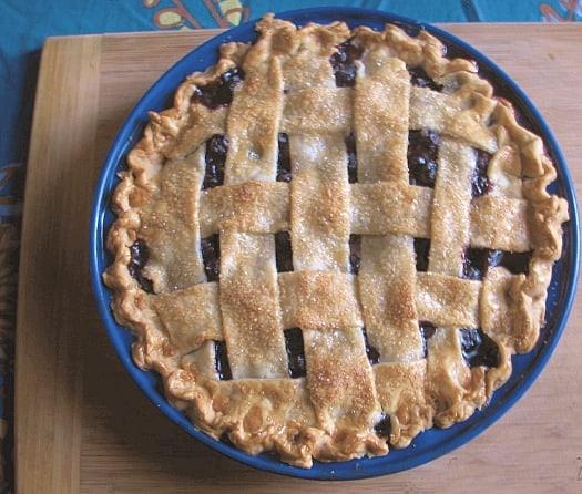 overhead shot of blueberry pie with lattice top browned crust