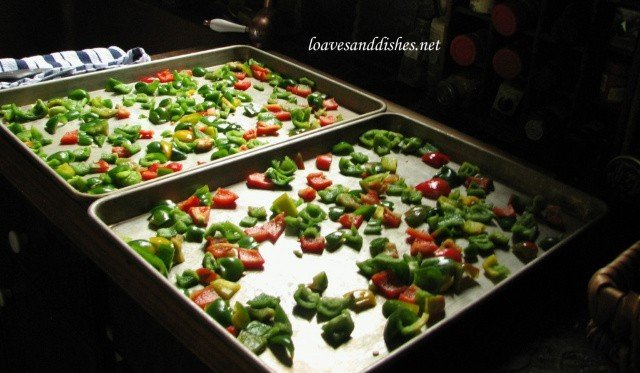 Bell pepper pieces spread out onto two baking sheets