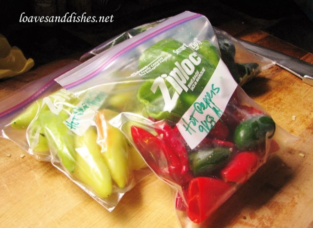 hot peppers in a quart sized freezer bag on a cutting board