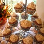 Pumpkin Spice Cupcakes with pumpkin cream cheese icing on cupcake tree with flowers in the back ground
