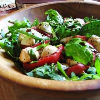 arugula salad in a wooden bowl