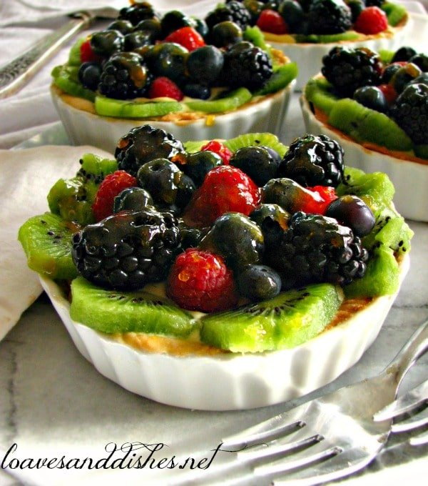 Mini Fruit Tart with kiwi, blackberries, raspberries and blueberries on top