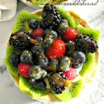 Mini Fruit Tart with glaze on a marble counter top