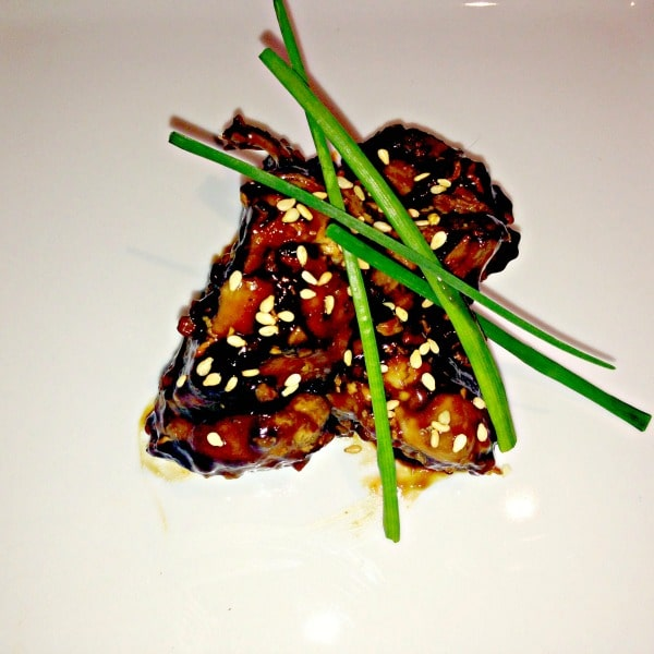 Teriyaki chicken with sesame seeds and chives on top
