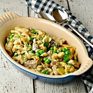 Easy Weeknight Beef Stroganoff in a blue dish with a black and white checked napkin