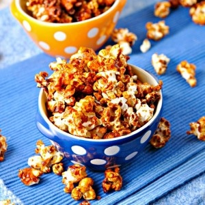 Freaky Hot Wing popcorn in a blue and yellow polka dot bowl on a blue towel