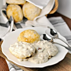 Plate of sausage gravy on two biscuits