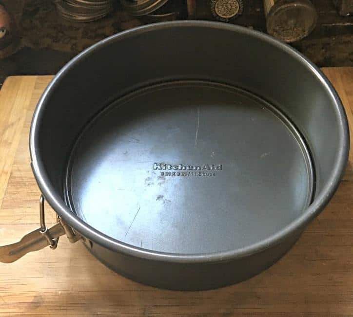 A photo of a spring form pan for Cinnamon Roll Cake from Scratch
