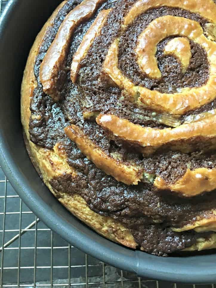 A close up of the edge of the cinnamon roll cake from scratch