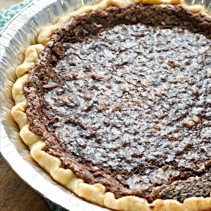 A 45 degree angle shot of the CHOCOLATE CHESS PIE showing the shiny upper crust