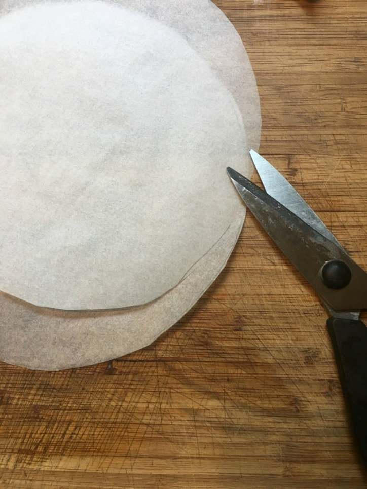 a photo of parchment paper circles for Southern Carrot Cake with Cream Cheese Icing