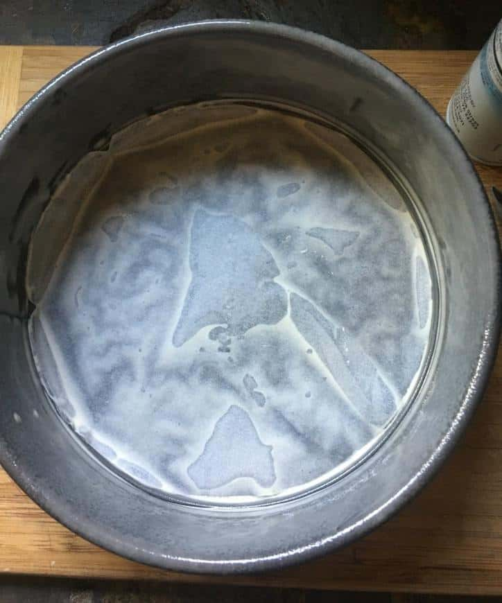 A photo of the parchment paper circle in the bottom of the springform pan