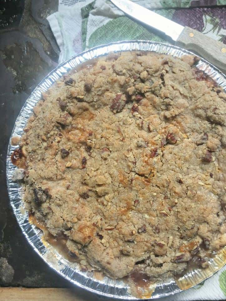A photo from above of the entire pie Peach Pie with a Pecan Brown Sugar Crumble