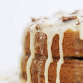 A view of the icing running down the sides of the pumpkin praline cake