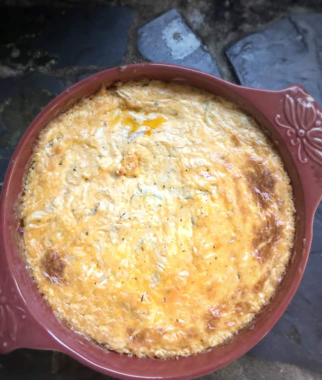 An overhead view of a round dish of buffalo chicken dip