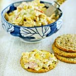 A photo of a bowl of pimento cheese with crackers