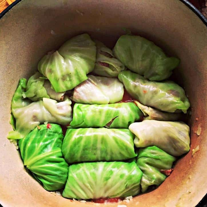 classic cabbage rolls tucked into the bottom of a dutch oven