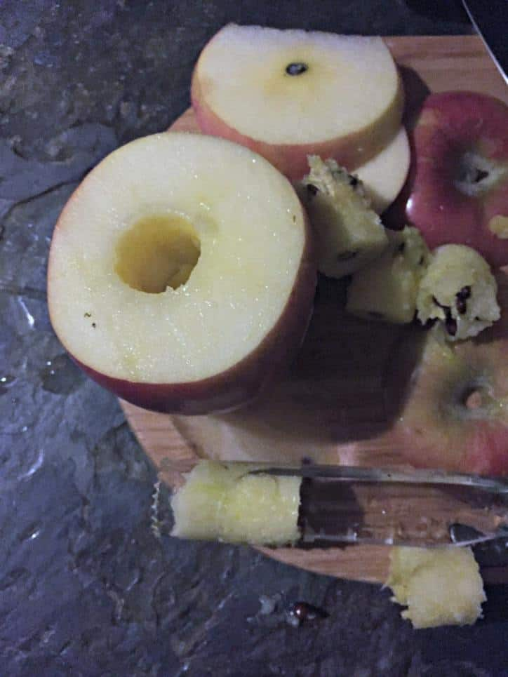 apple on cutting board with the core removed.