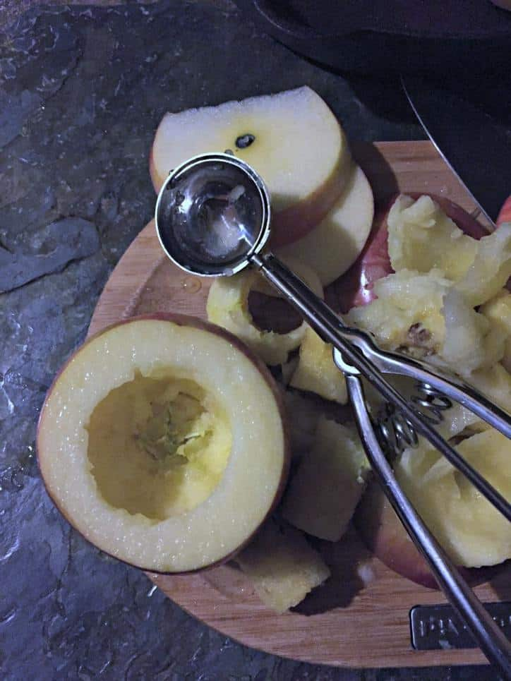 apple on cutting board with scoop