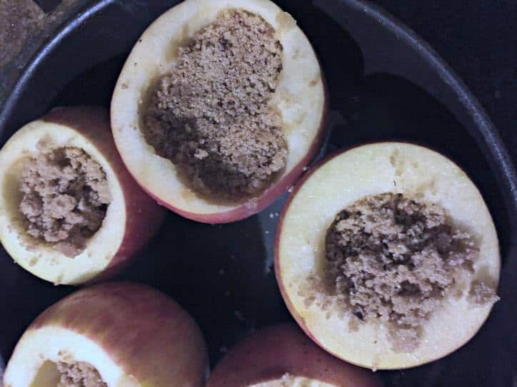 apples in the pan with the brown sugar mix in the center.