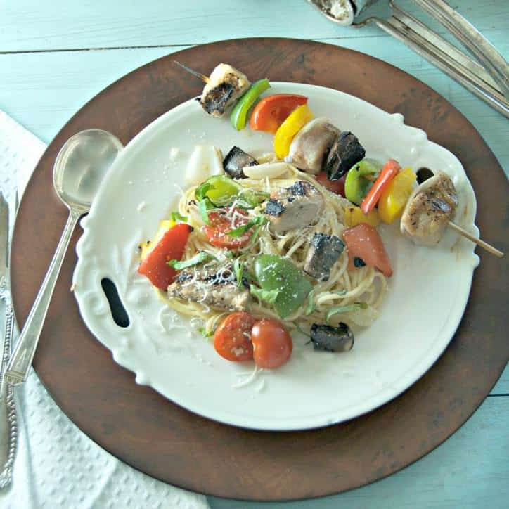 Kabob and pasta on a white plate for how to cut an onion for kabobs