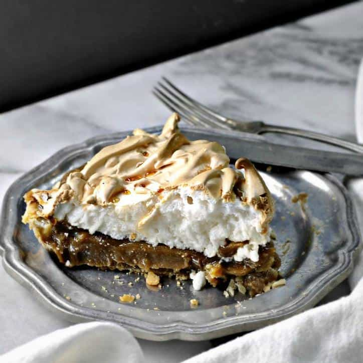 A photo of a slice of Old Fashion Butterscotch Pie www.loavesanddishes.net