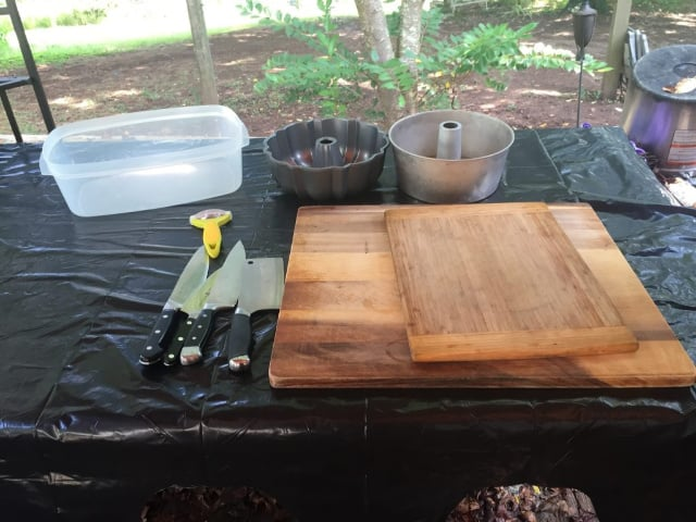 cutting board, knifes, containers assembled for project