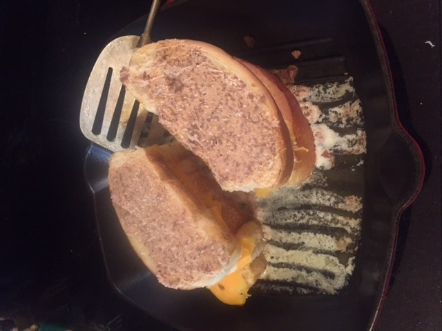 Two grilled chocolate cheese sandwiches in a frying pan
