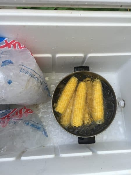 Icing the corn down to stop the cooking process