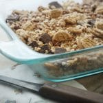 A close up photo of a glass pan with Chocolate Nutter Butter Crispy Treats in it!