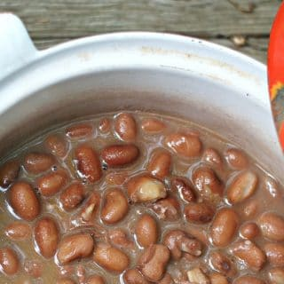 A close up of the pinto beans in a dutch oven showing the pot liquor