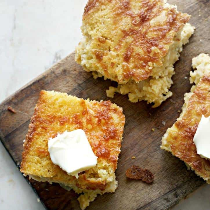 Southern Mexican Cornbread on a cutting board with butter on top