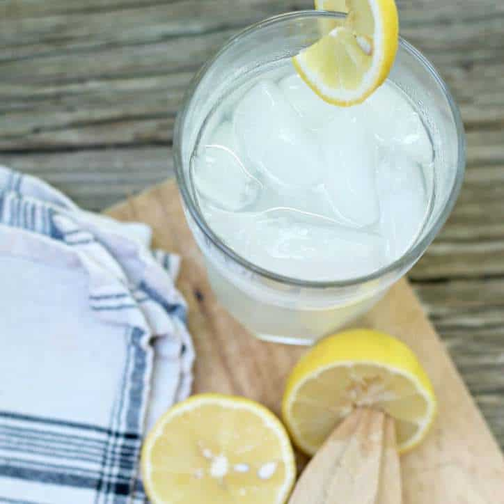 A photo of a cold glass of FRESH HOMEMADE LEMONADE CONCENTRATE from the top