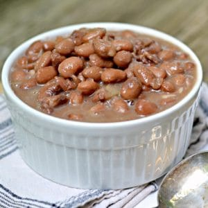 Side view of a bowl of hot beans in The Secret to Perfect Old Fashioned Pinto Beans