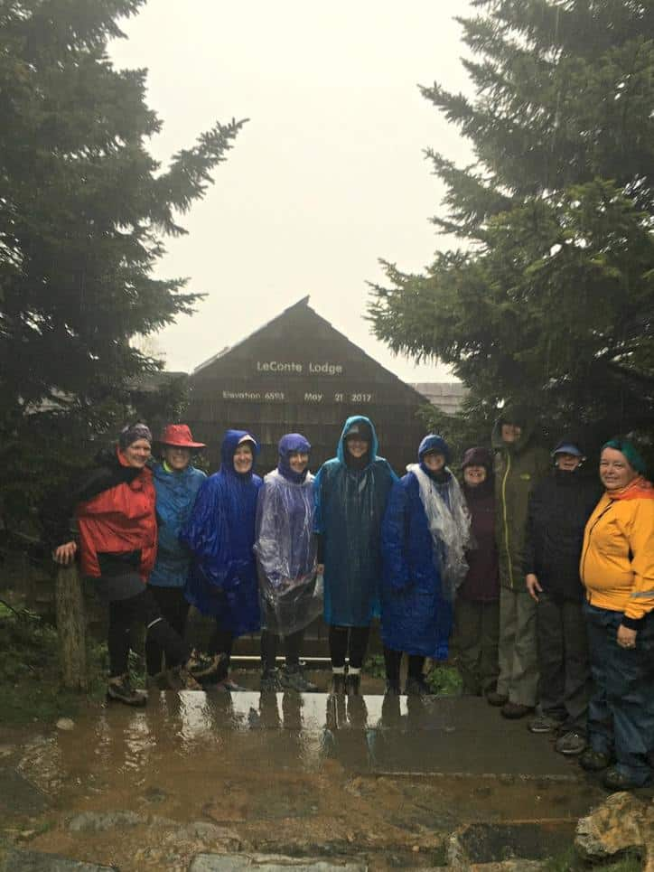 This is a photo of the hiking group in front of Mt. Leconte lodge in the pouring rain