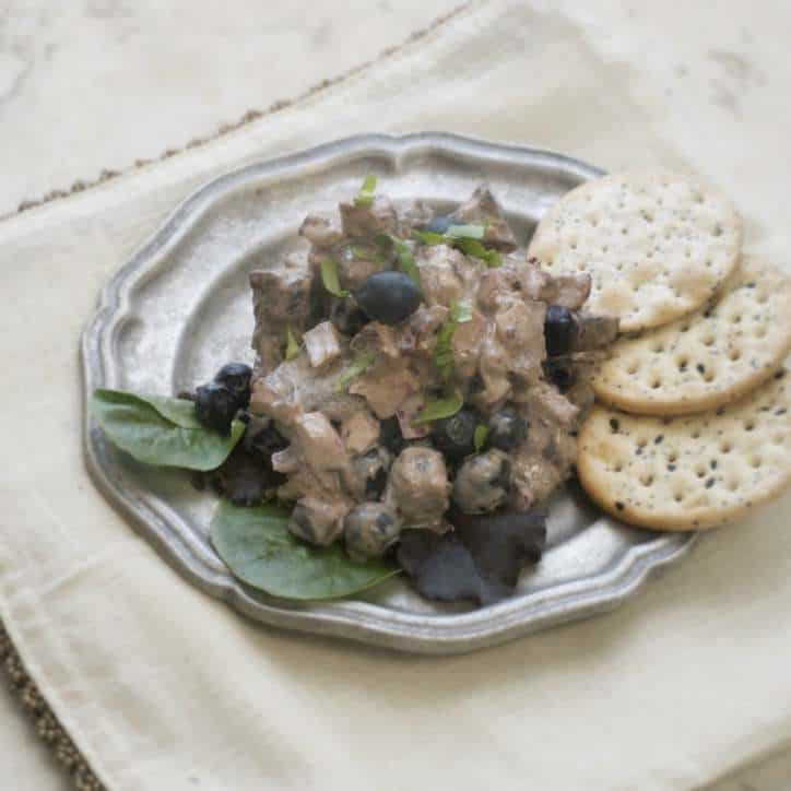 Blueberry Balsamic Chicken Salad on a pewter plate with green fresh lettuce