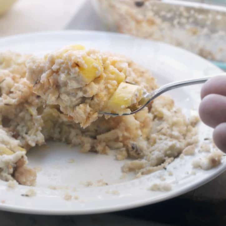 A photo showing a spoonful of the Easy Cheesy Southern Squash Casserole