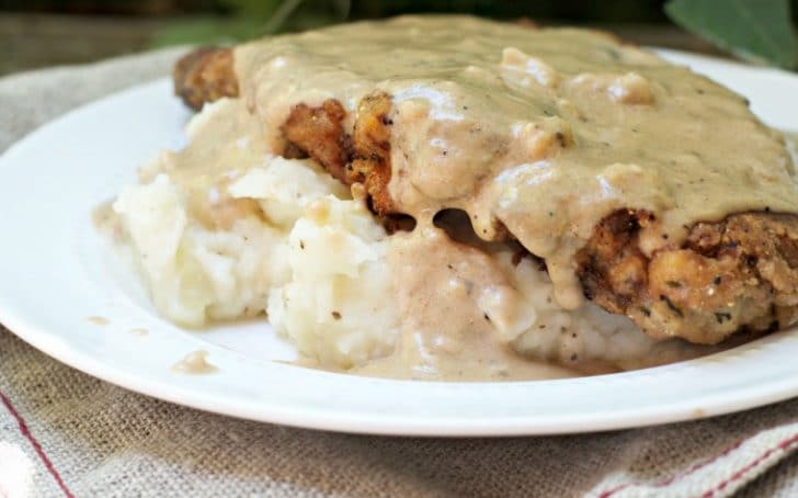A photo of the side of the The Secret to Perfect Chicken Fried Steak with the gravy dripping down