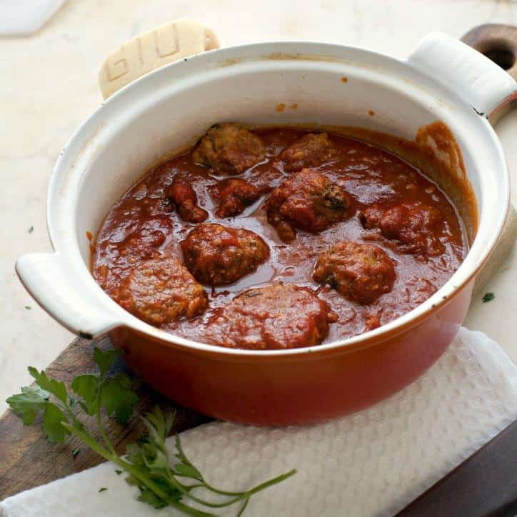 A photo of the Blow Your Mind Meatballs in the pot they are cooked in slightly from the side
