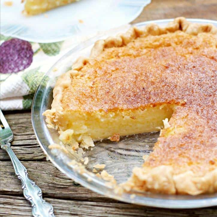 This is another photo of the Old Fashioned Lemon Chess Pie with a slice out and it is turned so you can see the inside of the pie