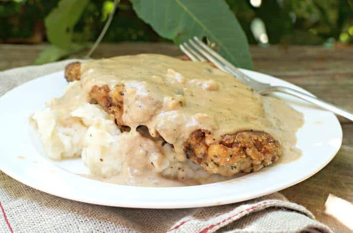 a photo of The Secret to Perfect Chicken Fried Steak with sunlight shining on the gravy