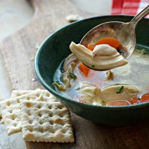 A photo of a spoonful of chicken meat in THE SECRET TO THE BEST CHICKEN SOUP