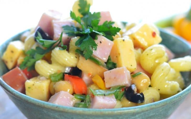A side view of a bowl of pasta salad for the post ALL THE SECRETS TO PERFECT PASTA SALAD