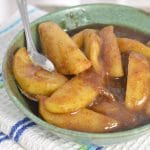 A photo of a bowl of fried apples with a spoon THE SECRET TO PERFECT SOUTHERN FRIED APPLES