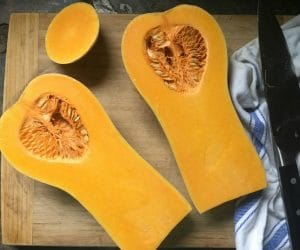 A photo of the bright yellow and orange colored flesh on the inside of a butternut squash