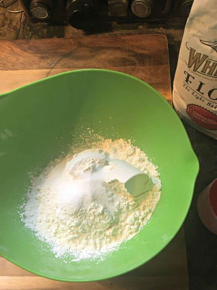 A photo showing the dry ingredients together in a bowl for Southern Buttermilk Biscuits