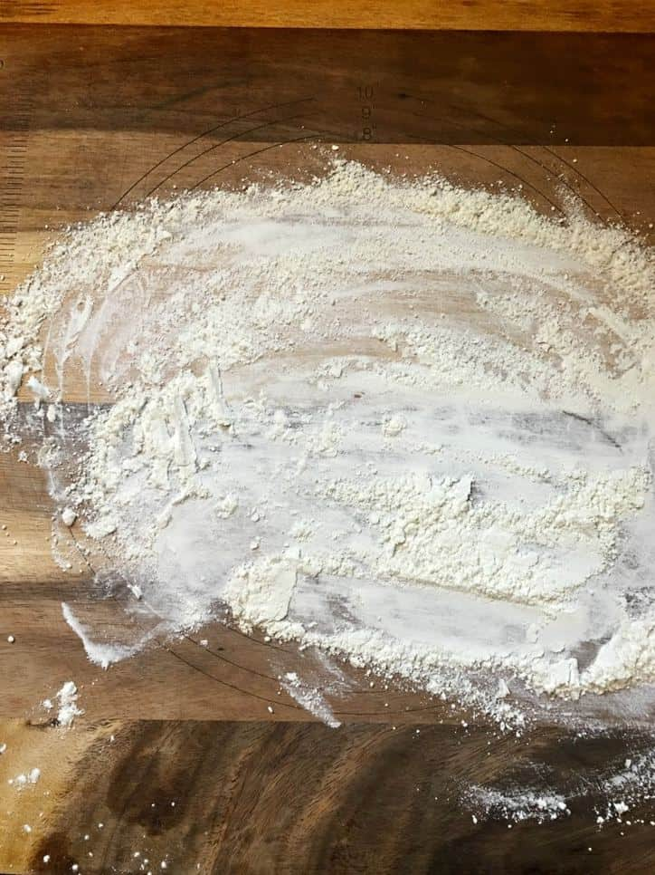 A photo of a floured bread board for Southern Buttermilk Biscuits
