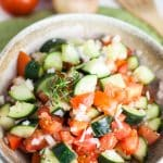 A horizontal photo of a close up shot of Zesty Cucumber Tomato Salad
