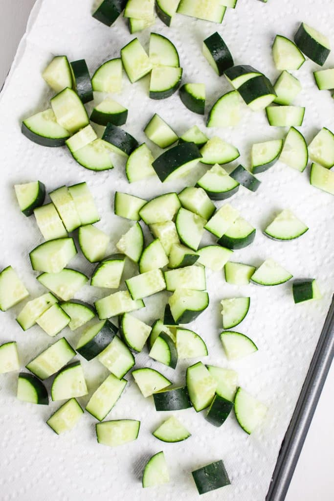 A photo of the cucumbers cut into pie shape pieces for zesty Cucumber and Tomato Salad
