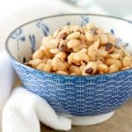 A close up view from the side of a bowl of black eyed peas for How to cook canned black eyed peas